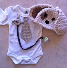 Crochet Handmade Puppy Dog Onesies, Outfit, Earflap, Beanie Hat And Accessories, Baby Pacifier Clip, Gift Kit Idea. $55.00, via Etsy.