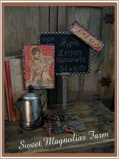 vintage store sign turned into an awesome kitchen blackboard.  Love it!