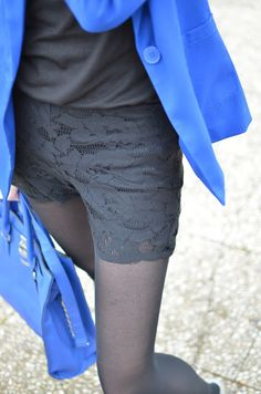 like this black lace shorts, black shirt, black tights, with cobalt blue blazer