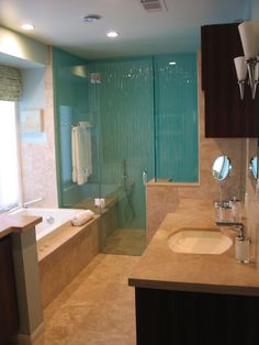 """Master Bathroom Spa Effect.  Shower enclosure walls are created from 3/8"""" Kiln - Formed bark texture with a aquamarine paint applied on the glass."""