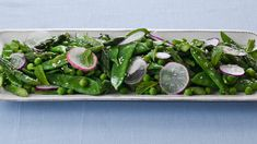 Spring Vegetable Salad: Seasonal spring vegetables such as peas, asparagus and radishes are tossed with a fresh mint and a light, lemony vinaigrette. Pumpkin Vegetable, Vegetable Salad, Vegetable Dishes, Vegetable Recipes, Crab Pasta, Bacon Pasta, Spice Set, Salmon And Asparagus, Frozen Peas