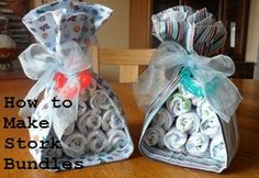 Easy inexpensive DIY baby shower gift -- stork bundles! Can be used as centerpieces!