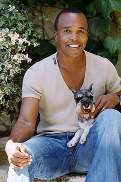 """This is a Picture of Sugar Ray Leonard holding his tiny little Salt and Pepper Miniature Schnauzer believed to be named """"Kit"""" what a really cute name for his dog, and what an AWSOME Picture Little Dogs, Big Dogs, I Love Dogs, Cute Dogs, Mini Schnauzer Puppies, Miniature Schnauzer, Schnauzers, Toy Schnauzer, Schnauzer Grooming"""