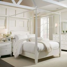 Beautiful white modern canopy bed with nightstand and dresser and mirror in nice bedroom.jpg 1,600×1,600 pixels