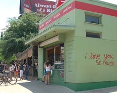 """Grab a coffee at Jo's on South Congress. Be sure to take a picture in front of the """"I Love You So Much"""" sign to send home to loved ones :)"""