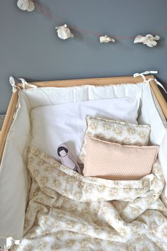 Hand Quilted Cot quilts, Printed small padded cushions, All by camomile london.
