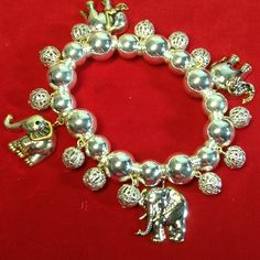 Selling this Elephant bracelet.    Silver tone touch of gold in my Poshmark closet! My username is: karenpaulovich. #shopmycloset #poshmark #fashion #shopping #style #forsale #Jewelry