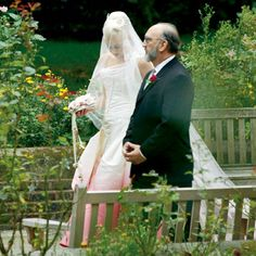 Stefani, with her father. Though best known for her belly-baring stage outfits, Stefani was transformed into a fairy princess in a custom-made pink-and-white silk faille Christian Dior gown—complete with an antique lace veil—designed by her friend, John Galliano. Her eight attendants wore bias-cut silk dresses from the Christian Dior Bridal Collection.