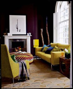 deep plum walls with vibrant yellow furnishings - complementary colors.