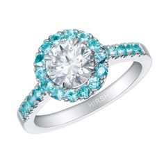 Hirsh London 1.03 carat D colour round diamond engagement ring, encircled by a halo of 24 Paraiba tourmalines in platinum. #bridal #engagementring #diamond #blue #hirshlondon