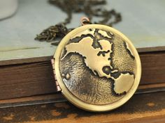 This vintage-inspired locket: | 23 Travel-Inspired Accessories To Satisfy Your Wanderlust