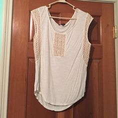 White T-Shirt White tank, with thick straps. Also with almost a knitted feel down the sides, and in the front. American Eagle Outfitters Tops Tank Tops