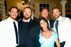 Wow, Linda Gibb is surrounded by a bunch of fine, strapping lads! Her four sons... with Barry Gibb.