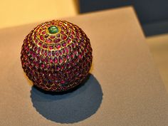 Sphere (Jewel)    16th Century India.  Made of Silver, Gilding, Rubies, Emeralds, Diamonds.