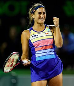 Monica Puig of Puerto Rico celebrates beating Caroline Wozniacki of Denmark during Day 5 of the Miami Open Presented by Itau at Crandon Park Tennis Center on March 2018 in Key. Monica Puig, Crandon Park, Tennis Center, Caroline Wozniacki, Beautiful Athletes, Tennis Players Female, Athletic Women, Tennis Racket, Puerto Rico