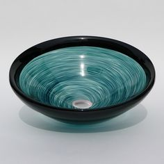 Simple elegance in a hand blown glass sink of twisted body color complimented by a black lip.