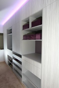 Luxe designer wardrobe, awesome pull out shoe shelves, dramatic lighting