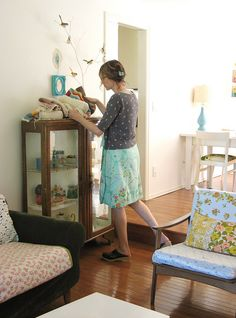 I Love how she painted the inside of this vintage curio cabinet white to make her treasures 'Pop'