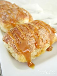 Pumpkin Caramel Empanadas Recipe ~ baked puff pastry layered around a pumpkin and cinnamon filling inside. Dusted and surrounded with cinnamon and sugar. Then, topped with drizzled caramel... Scrumptious!