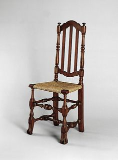 """1700-1740 Bermudian Side chair at the Metropolitan Museum of Art, New York - From the curators' comments: """"The cresting, the simplicity of the banisters, and the turned stretchers placed high on the legs connect this chair to numerous similar examples that have survived in Bermuda."""""""