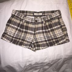 Abercrombie Brown plaid shorts Brown, cream, tan plaid, checker-striped shorts. Very gently worn No pulling, no stains, no holes. Excellent condition. Says Size 00 will fit size 2. Abercrombie & Fitch Shorts