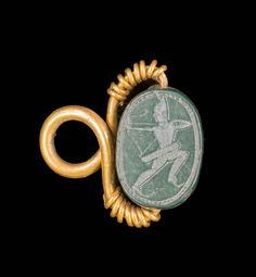 This Phoenician jewel shaped Egyptian scarab with a gold mount has been carved in green jasper. While the top has all the characteristics of the insect, the underside represents an archer pulling over his shoulder. Medieval Jewelry, Ancient Jewelry, Antique Jewelry, Gold Jewellery Design, Gold Jewelry, Archer, Bohemia Jewelry, Ancient Artifacts, Historical Artifacts