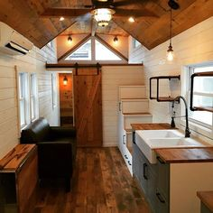 Modern farmhouse tiny house on wheels with storage stairs and