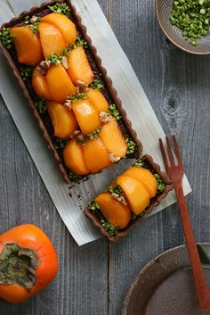 // persimmon and chocolate tart.  i luv persimmon recipes because my dad has a persimmon tree and every fall we literally have thousands of persimmons!