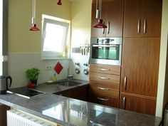 white yellow small kitchen | Image of a kitchen, just big enough to fit two people standing side-by ...