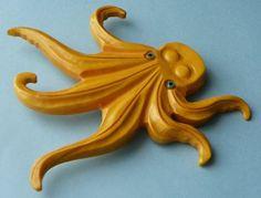 Vintage Bakelite octopus brooch.  #vintage #jewelry #brooches