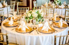 Gold table setting idea - white table linens with gold Chiavari chairs and gold chargers {Daniel Hon Wedding Photography}