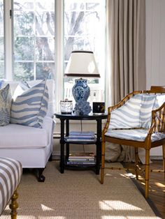 Okay...so this is what I love about white slip covers and dark woods and neutral panels...you can warm it up for colder fall and winter months...and change out the pillows to this crisp clean look for the hot humid long days of summer!!!!!