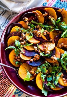 A colorful winter beet and persimmon salad bursting with all the flavors of the season; citrus in the dressing, smoky paprika, and spicy maple candied peanuts for texture and crunch. Vegan and gluten-free! Winter salad recipe. Vegan recipe.