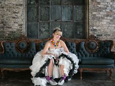 Love this bride's black and white gown paired with a gumball necklace and quirky winged sneakers!