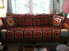 "From fan Katie Pouch: ""Made your sunflower throw for my fall couch afghan. Really loving the pillows."""