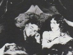 """Charlie and Edna Purviance sharing a bed on set of """"A Women Of Paris""""."""