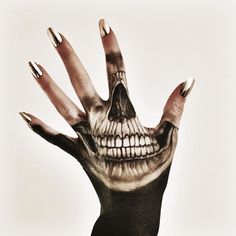 """""""Some skull hand art I did today. I think it turned out okay. Inspired by tattoo art.""""  by Vanessa Davis"""