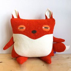 #foxy pillow: inspiration for a sewing project. You could adapt this idea for a whole menagerie of pillow animals!
