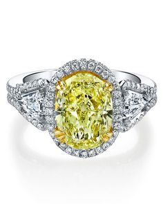 """I HAVE A LARGE HANDS - We're guessing that only you think so! That said, a wider setting, such as a split shank, flatters any finger size.Harry Kotlar """"Crescendo"""" Yellow Diamond Engagement Ring, $51,355, harrykotlar.com."""