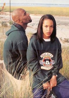 Pop art became popular again in clothing. This is a photo of Aaliyah wearing a Mickey Mouse sweatshirt with R. Kelly.