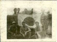 503rd, 462nd artillery men pose with a captured Japanese flag.  Corregidor, Top-side parade grounds.