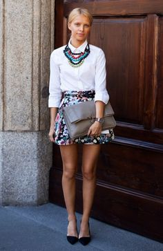 A chunky colorful necklace can transform a simple white shirt into a stylish evening look.
