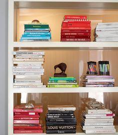 Bookshelves organized by color make pretty displays.