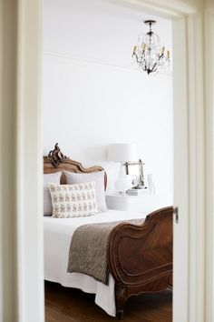 beautiful antique wood bed dressed in white french linens for the guest room <3
