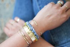 DIY Braided Cuff. I think the possibilities are endless with this idea.