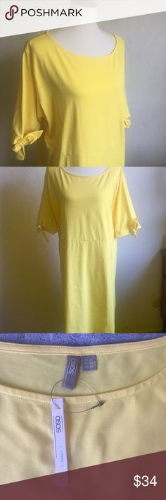 """ASOS (Curve) Yellow T-Shirt Dress 20 Yellow T-shirt dress, short sleeves, the sleeves have ties for bows, it is unlined and there are no pockets, 🌸please note the light discoloration on the back of one sleeve shown in the last picture.   25"""" x 38""""  🌷Thank you for visiting my closet! ASOS Curve Dresses Midi"""