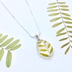 Real leaf Necklace - Handmade with real pressed leaf and eco resin. Natural jewellery, eco resin jewellery :) This necklaces are showcasing real leaves. The flower was pressed and dried and then embedded into the clear resin, that will preserve its beauty for a long time. Great romantic