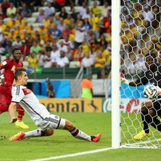 Miroslav Klose equallises for Germany against Ghana - Miroslav Klose of Germany scores his team's second goal past Fatawu Dauda of Ghana during the 2014 FIFA World Cup Brazil Group G match between Germany and Ghana in Fortaleza on June 21, 2014.