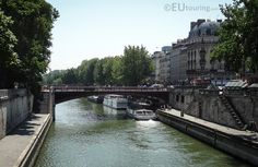 View of the Pont au Double pedestrian bridge crossing over the River Seine leading to the famous Notre Dame.  You may be interested in more; www.eutouring.com/images_pont_au_double.html