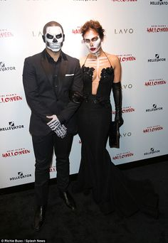 Two cute: Jennifer Lopez brought her boyfriend Casper Smart; they wore matching skeleton costumes